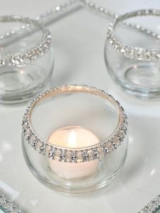"""Classic elegance. Use simple tea light votive and a rhinestone ribbon on the edges. For the glass """"plate"""" use a picture frame glass and glue the matching ribbon around the edges. No tutorial."""